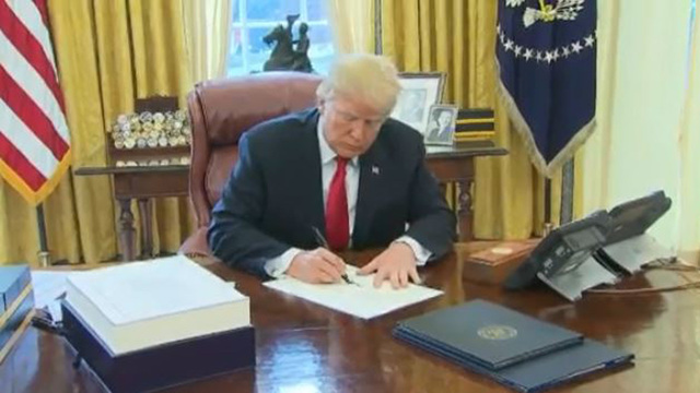 Donald Trump signs Tax Cuts Act into law