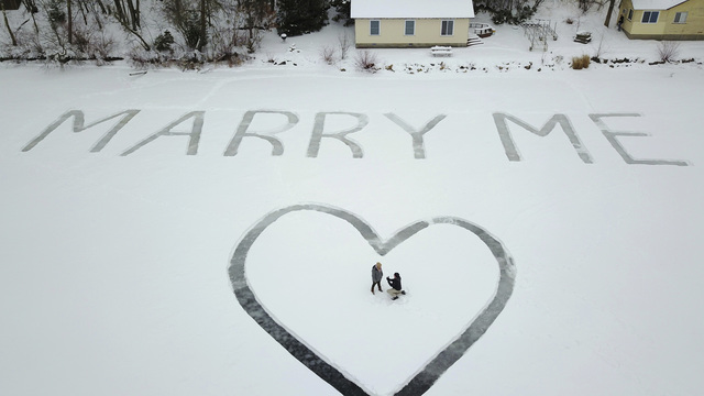A lofty proposal: 'Marry Me' etched in snow, seen from above