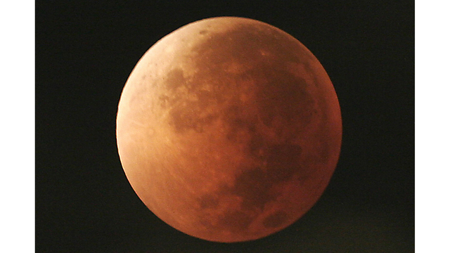 Blue moon, super moon, total lunar eclipse rolled into one