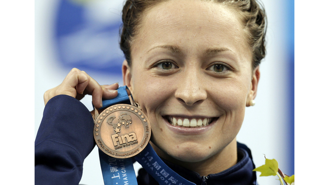 Former world swimming champ says coach sexually abused her