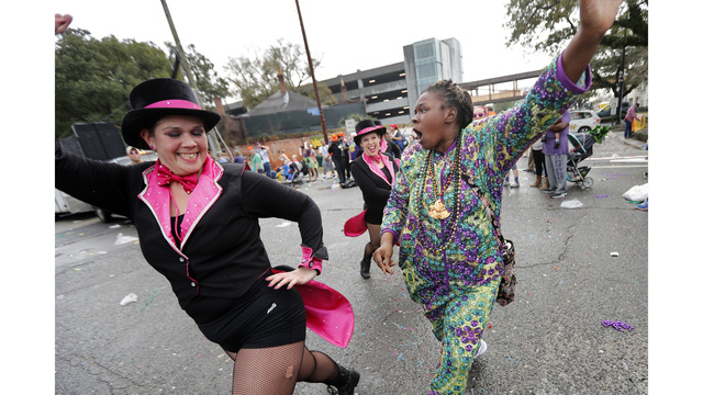 The Latest: Staying warm a Mardi Gras theme this year