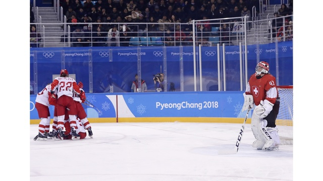 US escapes Slovakia for 1st men's hockey win in Pyeongchang