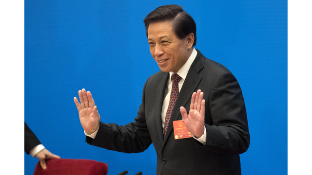 China sets growth target, set to end president term limit