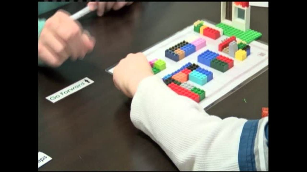 Kids use Legos to understand rules of computer coding