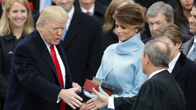 Donald Trump shakes hands with Justice John Roberts after being sworn in03914281