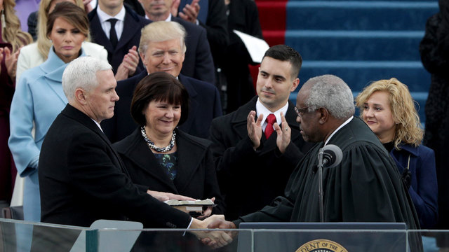Mike Pence shakes hands with Clarence Thomas at inauguration04188538