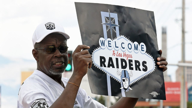 Raiders fan holding Welcome to Las Vegas sign53288288