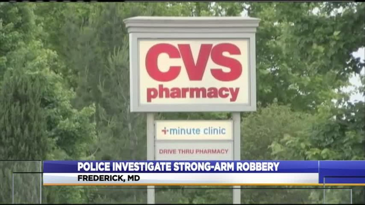 police release image of two suspects after robbery at cvs pharmacy