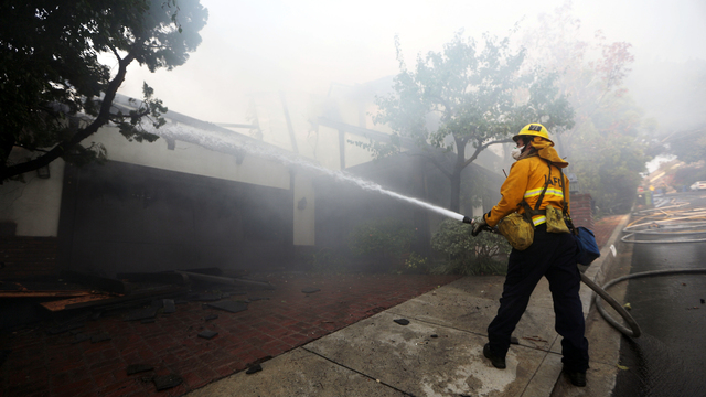 Southern California firefighters race against time, winds