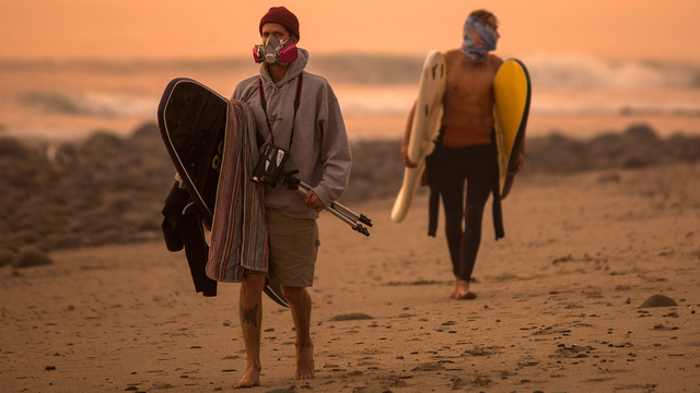 Thomas Fire in California Dec 12 surfers in Carpinteria.jpg96760185