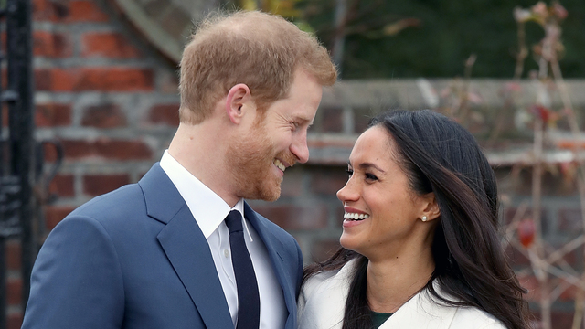Prince Harry and Meghan Markle stare.jpg83006580