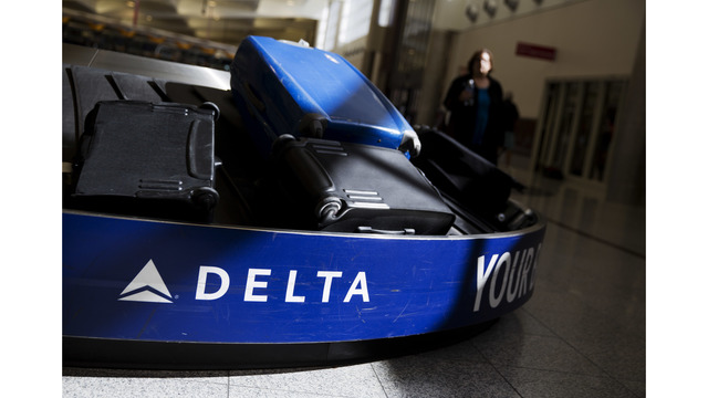 Delta flight evacuated in Denver because of smoke in cabin