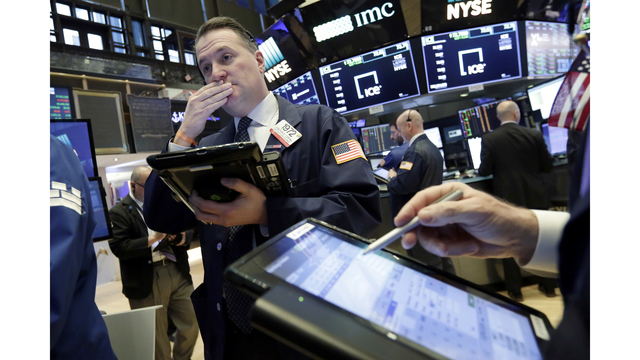 Wall St hit by trade war fears; jobs data ease rate concerns
