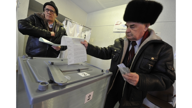 Putin headed for easy re-election in Russia's presidential race - 6 more years