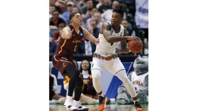 Lonnie Walker: Hires agent, will remain in NBA Draft