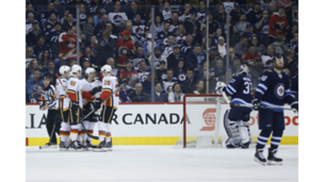 Connor Hellebuyck: Sets new National Hockey League record for wins by American goaltender
