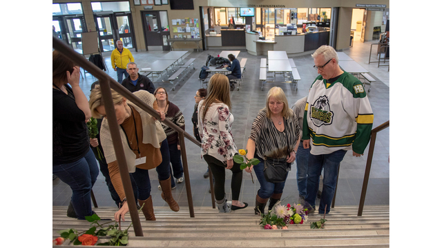 Hockey bus crash survivors hold hands in hospital
