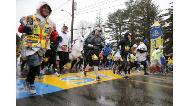 The Latest: Women's runner-up in Boston a previous unknown