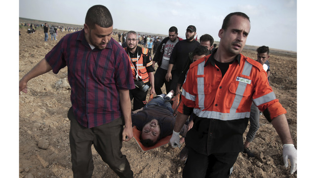 Slain Palestinian lecturer buried in Gaza