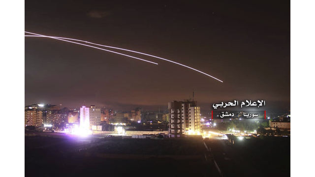 Israel warns Iran and Syria of retaliation after rocket attacks