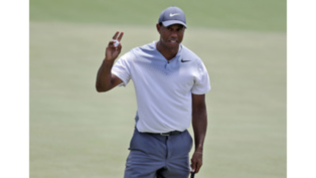Woods rediscovers that Tiger magic with 65 in Players third round