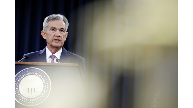 Fed raises interest rates and signals faster hikes on the way