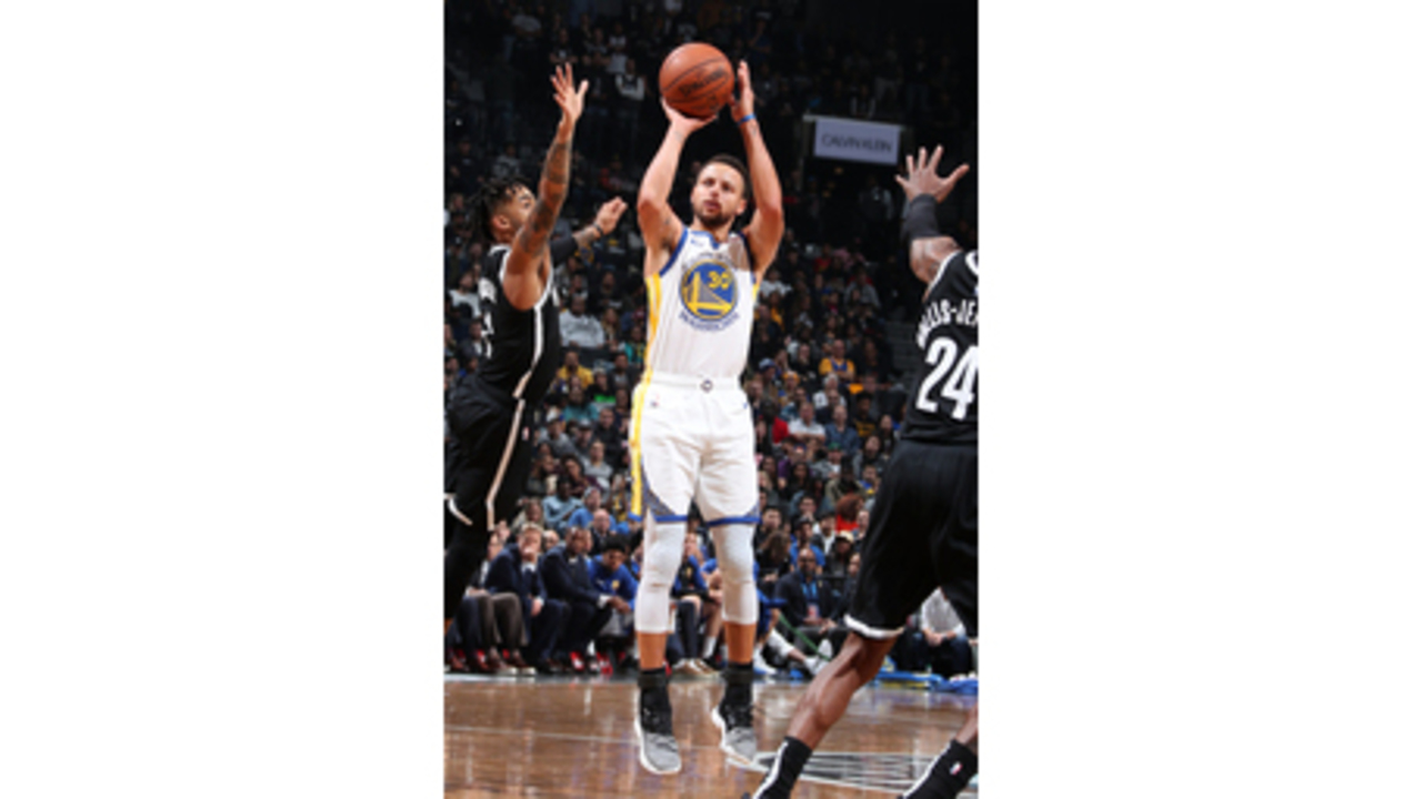 7c4b32916cd Curry sets another record for 3s, Warriors hold off Nets
