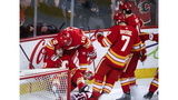 Bennett leads surging Flames over Wings