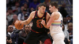 Jokic has 19-12-11 as Nuggets rout Cavs