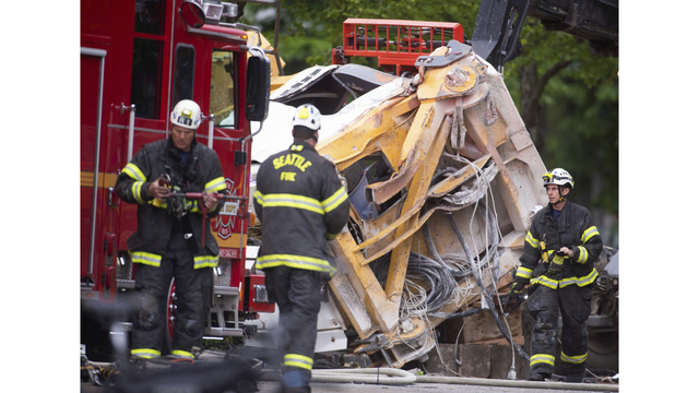 The Latest: Crane collapses in downtown Seattle, kills 4