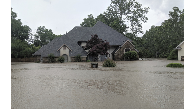 River nears crest in west Arkansas, but more rainfall looms